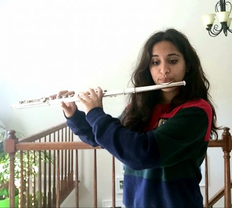 "Sanya Ahuja, sophomore band member, practices playing her flute to prepare for the ILMEA audition. ""I"