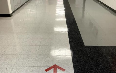 Hallways such as the S-Hallway shown here have been sanctioned off as a one-way hallway for hybrid learners. Other hallways have been divided into two sides in order to promote social distancing.