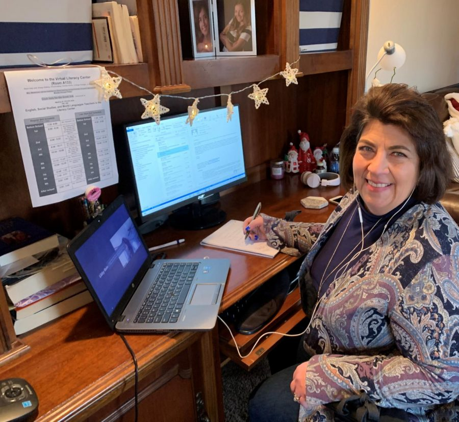 "Rose Weismann, literacy resource center aide, working at her home office. In the past few months, she says she has been ""busier now than ever"" as she helps students navigate the difficulties of digital learning."
