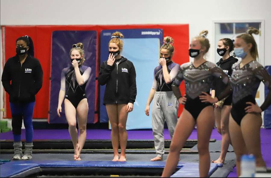 The+girls+gymnastics+team%2C+competing+at+a+meet+this+year.+Many+of+the+Winter+sports+have+faced+restrictions+or+postponement+due+to+COVID%2C+but+are+still+going+strong.