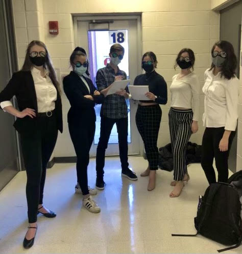 Brittany Rogus, senior, (far left) and her friends before a choir audition. Rogus says that extracurriculars such as choir and theater are so much more meaningful as a five-day senior.