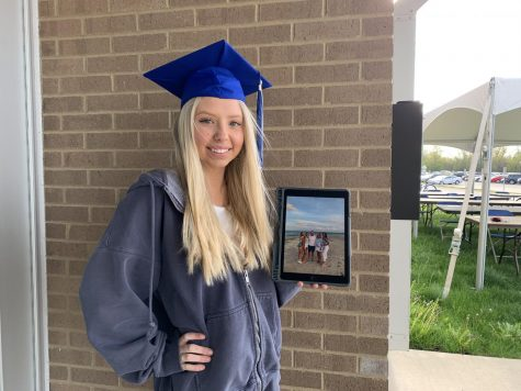Lauren Polsdorfer, senior, with a picture of her family in North Carolina. She will be moving to North Carolina after graduation to be with her sister.