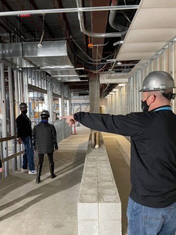 Ryan Rubenstein, assistant principal, (right) points out the new  construction updates that have been in  progress beginning on March 1.