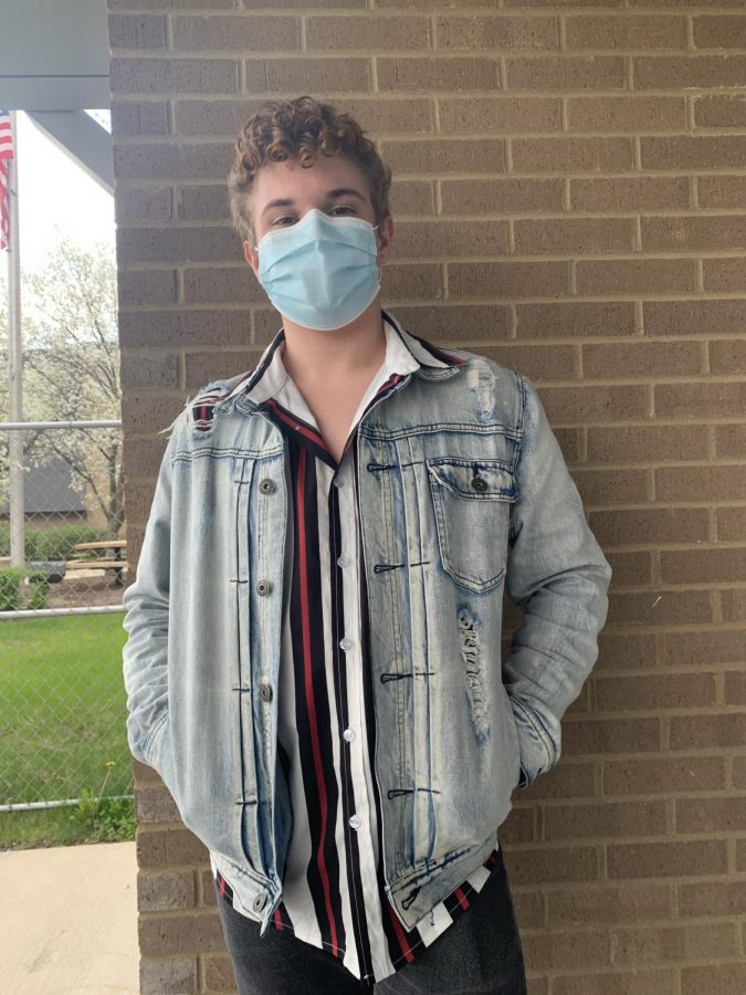 Matthew Shaw, junior, in his favorite thrifted item: his jean jacket. Shaw says thrifting is something everyone should try at least once.