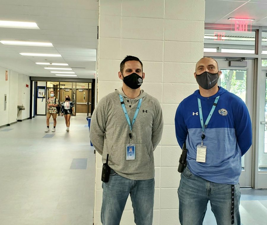 Mark+Frey%2C+school+resource+officer%2C+stands+with+Matt+Aiello%2C+dean+of+students%2C+across+from+the+main+office%2C+where+they+normally+greet+students.+%E2%80%9CHe+listens%2C+he+doesnt+lecture.+He+is+there+to+listen+and+he+will+offer+advice.+Hes+at+all+the+events+and+hes+there+as+a+person+who+wants+to+be+there%3B+hes+got+no+other+agenda%2C%E2%80%9D+Aiello+said.+%E2%80%9CHe+wants+to+be+there+for+the+students%2C+he+wants+to+be+there+for+the+staff.+He+can+take+a+joke+and+he+can+give+a+joke.+I+think+just+his+demeanor%2C+you+see+him+and+I+often+in+the+halls+and+we+try+to+say+hi+to+everybody.+He+tries+to+say+%E2%80%98hi%E2%80%99+to+everyone+and+jokes+with+everybody.+I+think+he+brings+a+really+calming+presence+to+our+building.%E2%80%9D