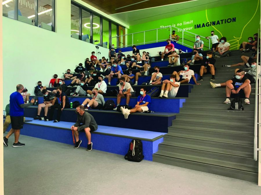 Pictured here are students utilizing the spaces during the school day, including before and after school. They use the brand new library and learning stairs to work collabortively together or simply getting their homework done. The library and steam room also feature new furniture and meeting rooms for students as well. Pictured above the football team uses the learning stairs to go over different strategies.