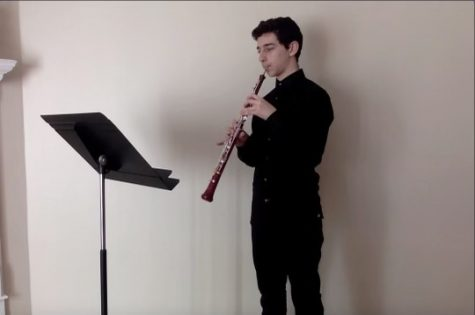 Matthew Nerenberg, sophomore and band student, in the middle of recording his oboe audition for ILMEA. Students were told to create a single video, encompassing all parts of the audition.